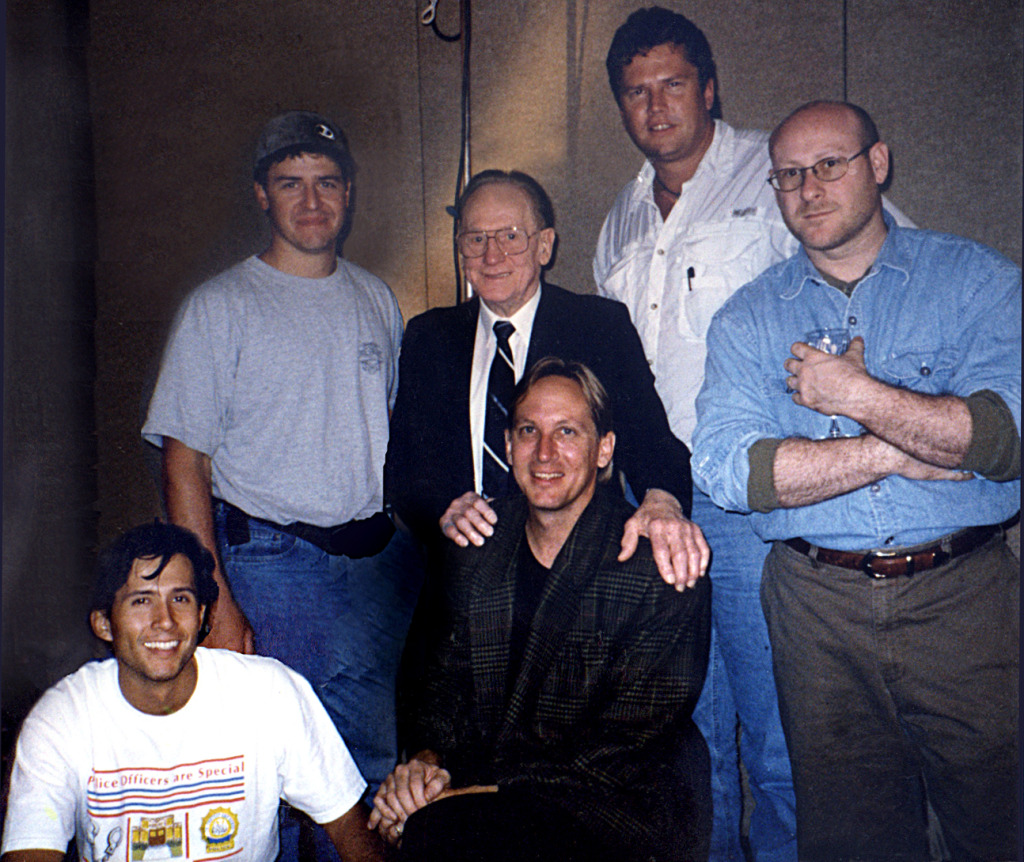 Film crew with legendary guitarist Les Paul. Left to right (standing): Director of Photography Patrick Longman, Producer Scott L. Gordon, Les Paul, Soundman Dean Gudmundson and Artist Coordinator Keith Schantz. Left to right (seated): Assistant Cameraman Andres Sanchez, Director/Producer Mark Moormann